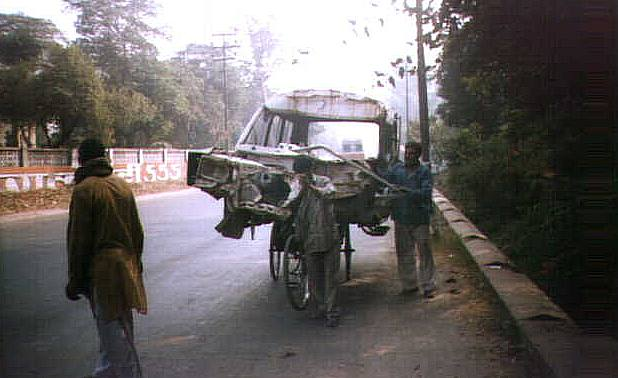 The humble but ubiquitous rickshaw, whose contribution to the Indian Economy perhaps equals those of many large industries. Note the front wheel is not on the ground.